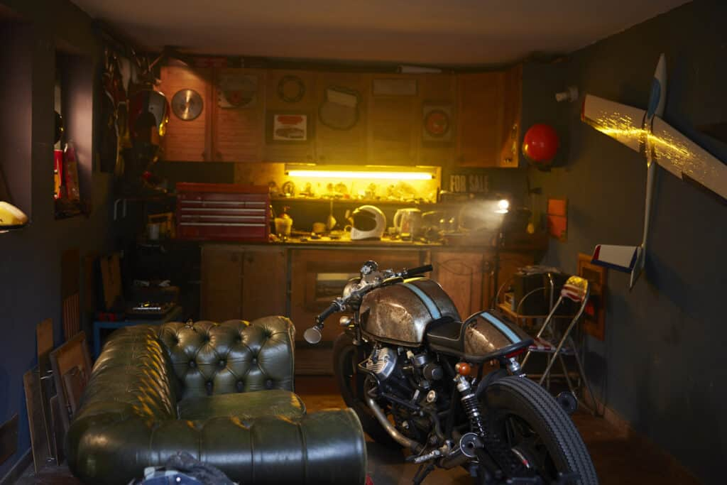 Fancy motorcycle storage shed with bike and leather couch